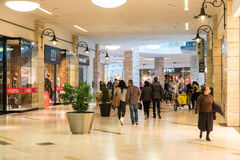People Shopping In Luxury Shopping Mall Interior. BUCHAREST, ROMANIA - JANUARY 27, 2015: People Shopping In Luxury Shopping Mall Interior Stock Photos