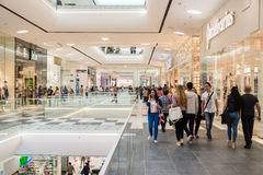 People Shopping In Luxury Shopping Mall Interior. BUCHAREST, ROMANIA - MAY 16, 2015: People Shopping In Luxury Shopping Mall Interior Stock Photo