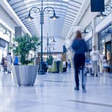 People in shopping mall. People moving in the center walkway of a large indoor shopping mall Stock Photos