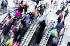 People in shopping mall. Motion blurred people in shopping mall stock image