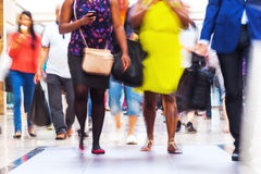 People in a shopping mall. People on the move in a shopping mall in motion blur stock photos