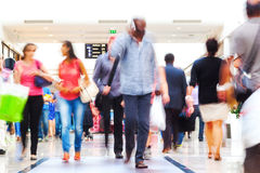 People in a shopping mall. People on the move in a shopping mall in motion blur royalty free stock photos