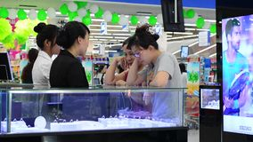 People in the shopping mall in Saigon stock footage