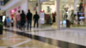 People shopping at mall stock video footage