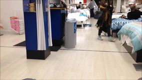 People shopping mattress. Inside Ikea store stock footage