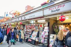 People shopping in Nakamise market, the traditional shopping street located at Sensoji Temple, Asakusa, Japan. People are shopping in Nakamise Shopping Street stock image