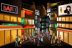 People shopping at night. A vector illustration of people shopping at a busy city center at night vector illustration