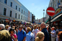 People shopping in notting hill London. People shopping at Portobello road London on a sunny day. Antique market in the arty Notting Hill district has become one Stock Photo