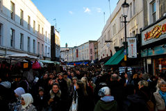People shopping in notting hill London. People shopping at Portobello road London on a sunny day. Antique market in the arty Notting Hill district has become one Royalty Free Stock Photography