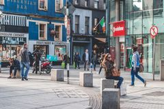 People shopping on Oliver Plunkett St, one of the city`s main streets for stores, street performers, restaurants, and busy city. April 13th, 2018, Cork, Ireland Stock Photos