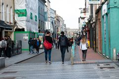 People shopping on Oliver Plunkett St, one of the city`s main streets for stores, street performers, restaurants, and busy city. April 13th, 2018, Cork, Ireland Stock Image