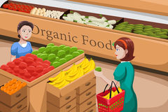 People shopping for organic food. A vector illustration of people shopping at an organic food aisle in a grocery store Stock Photos