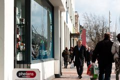 People shopping on Patrick Street in Cork, the city`s main street for stores, street performers, restaurants, and busy city life. April 13th, 2018, Cork Stock Photos