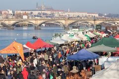 People shopping at the popular farmers market at the Naplavka ri. PRAGUE, CZECH REPUBLIC - NOVEMBER 17, 2018: People shopping at the popular farmers market at royalty free stock photo