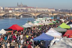 People shopping at the popular farmers market at the Naplavka riverbank in Prague. PRAGUE, CZECH REPUBLIC - FEBRUARY 16, 2019: People shopping at the popular stock images