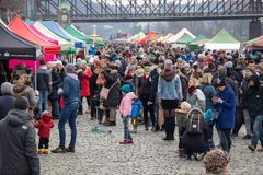 People shopping at the popular farmers market at the Naplavka riverbank in Prague. PRAGUE, CZECH REPUBLIC - DECEMBER 16, 2017: People shopping at the popular stock photography