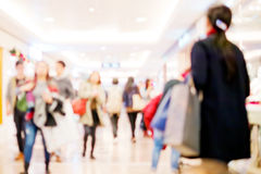 People shopping in retail mall Stock Images