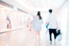 People shopping in retail mall Stock Image