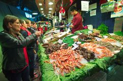 People shopping for sea food  in the Barcelona La Boqueria Marke Royalty Free Stock Photography