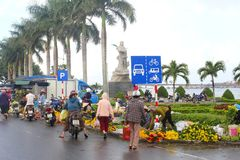 People shopping selling flowers outdoor street market, Dong Hoi, Vietnam royalty free stock image