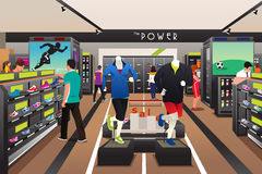 People Shopping for Shoes in a Sporting Store Royalty Free Stock Images