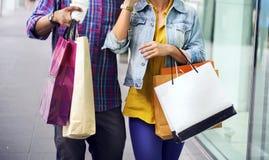 People Shopping Spending Customer Consumerism Concept. People Spending Enjoying Shopping Concept Stock Photos