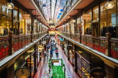 People shopping at the Strand Arcade in Sydney. SYDNEY, AUSTRALIA - November 2, 2017: The Strand Arcade is a multi level Victorian-style gallery with a glass Stock Photos