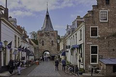 Shopping street and Vischpoort in fortified Elburg Royalty Free Stock Images
