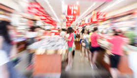 People shopping in the supermarket Stock Image