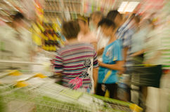 People shopping in the supermarket, the fuzzy move stock photo