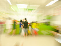 People shopping in the supermarket, the fuzzy move Royalty Free Stock Photography