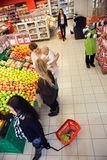 People Shopping In A Supermarket Stock Image