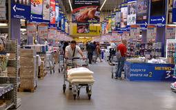 People shopping in supermarket Stock Image