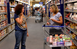 People shopping in supermarket Royalty Free Stock Images