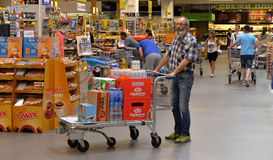 People shopping in supermarket Stock Photos