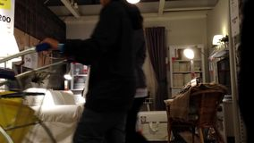 People shopping their furniture inside Ikea store stock video footage