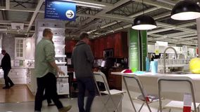 People shopping their furniture inside Ikea store stock video
