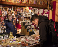 People shopping at the traditional Christmas markets at the Peace Square Namesti Miru in Prague, Czech republic