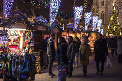 People shopping at the traditional Christmas markets at the Peace Square Namesti Miru in Prague, Czech republic Royalty Free Stock Photos