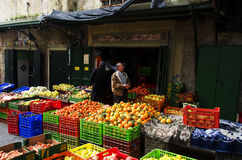 People shopping for vegetables in a market Royalty Free Stock Photo