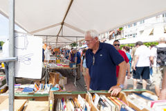 People shopping at white book stalls Royalty Free Stock Photos