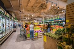 People shopping at Whole Foods stock image
