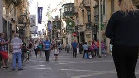 People,shops,pharmacy in Valletta city,Malta stock footage
