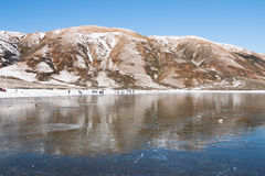 People on the shore of a frozen lake Royalty Free Stock Photography
