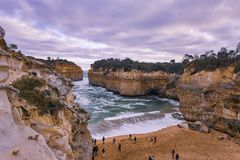 People on Shore Sea Cove Beside Cliff Nature Photography Stock Photo
