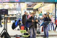 People show on Mongkok street Royalty Free Stock Image