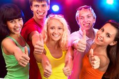 People show thumb up. Happy young people show thumb up Royalty Free Stock Photography