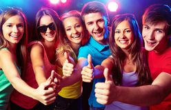 People show thumb up. Happy young people show thumb up Stock Photos