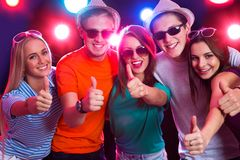 People show thumb up. Happy young people show thumb up Royalty Free Stock Images