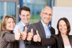 People Showing Thumbs Up Sign In Office Stock Photo